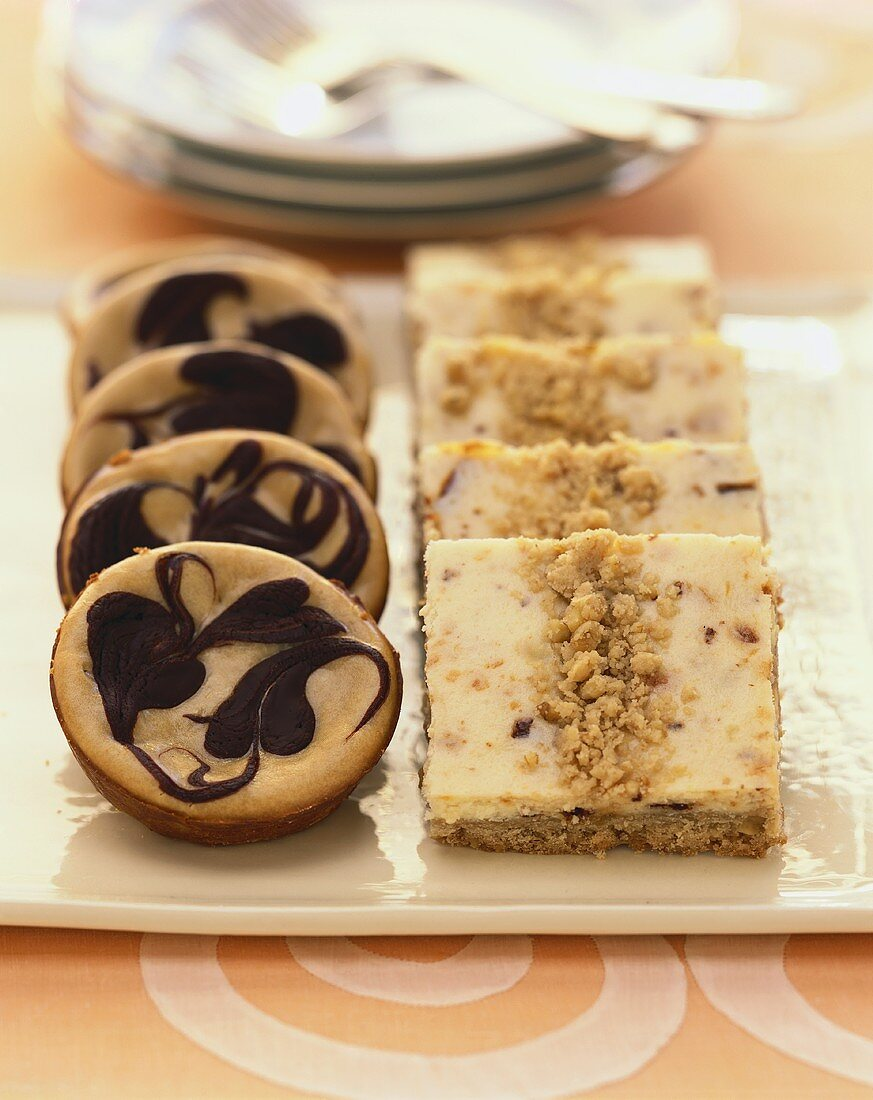 Individual Chocolate Swirl Cheesecakes and Nut Crumble Bars on a Platter