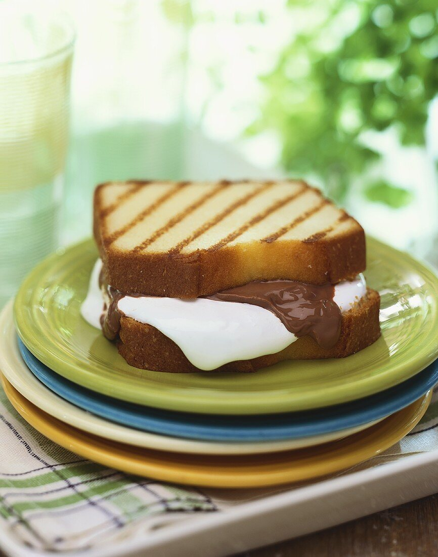Grilled Pound Cake S'more on a Stack of Plates