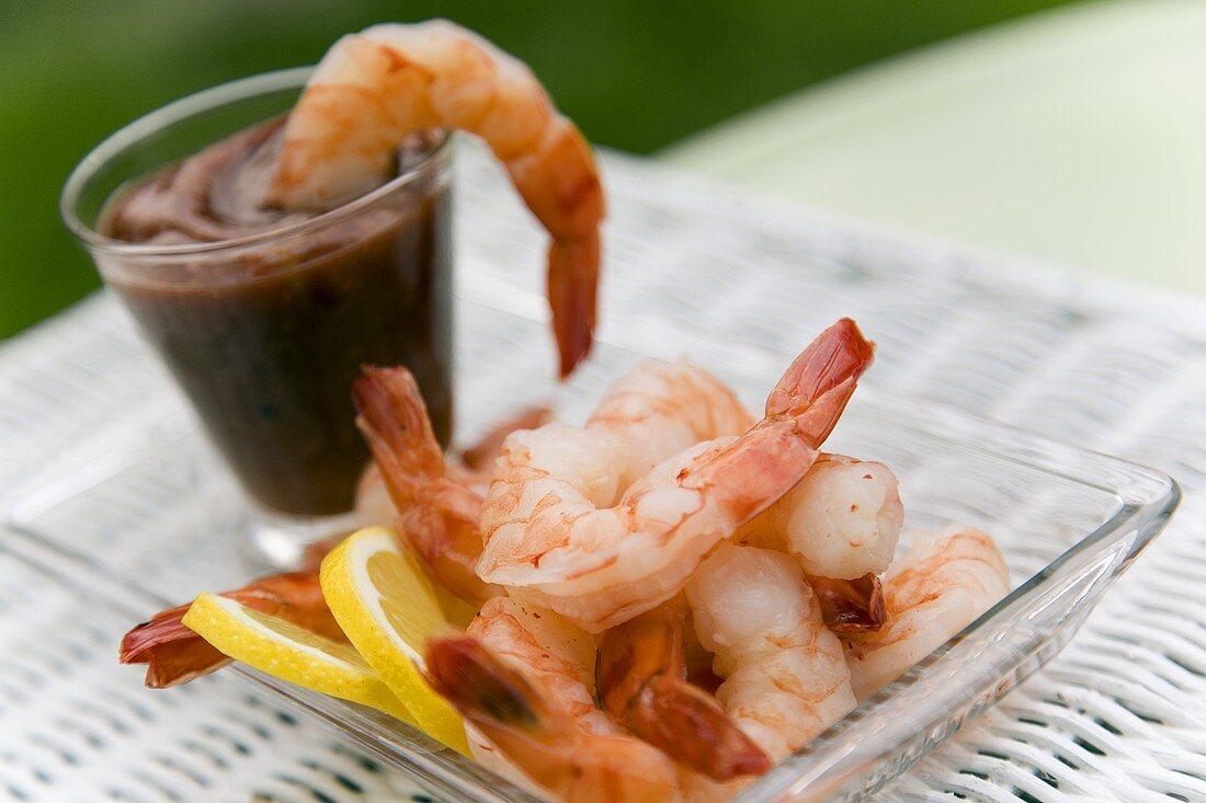 Shrimp Cocktail on a Glass Dish; Shrimp in Sauce