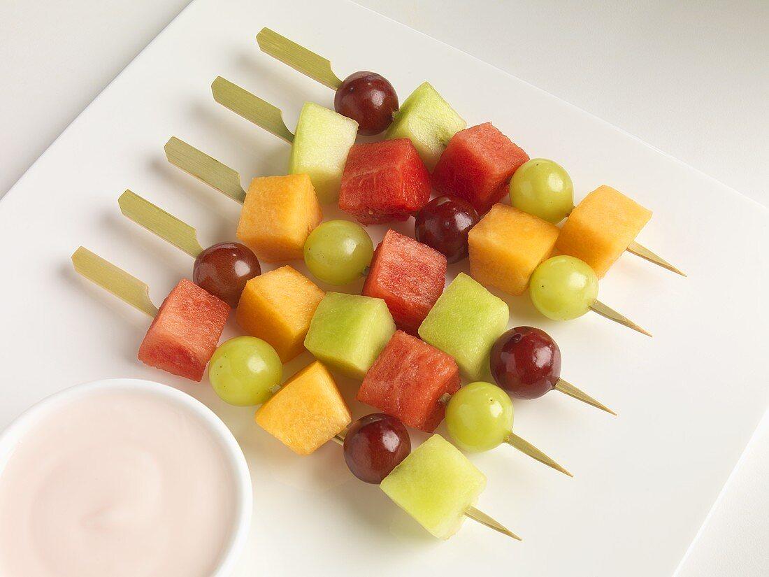 Fruit Skewers on a Plate with Raspberry Yogurt Dip