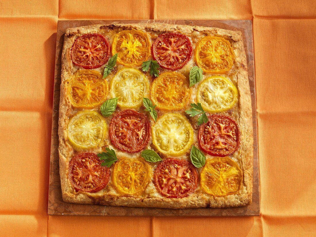 Tomato and Cheese Galette with Red, Orange and Yellow Heritage Tomatoes