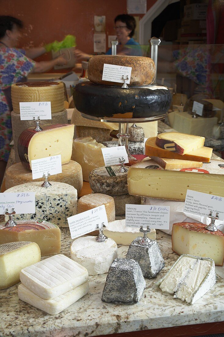 Display of cheeses on a market stall