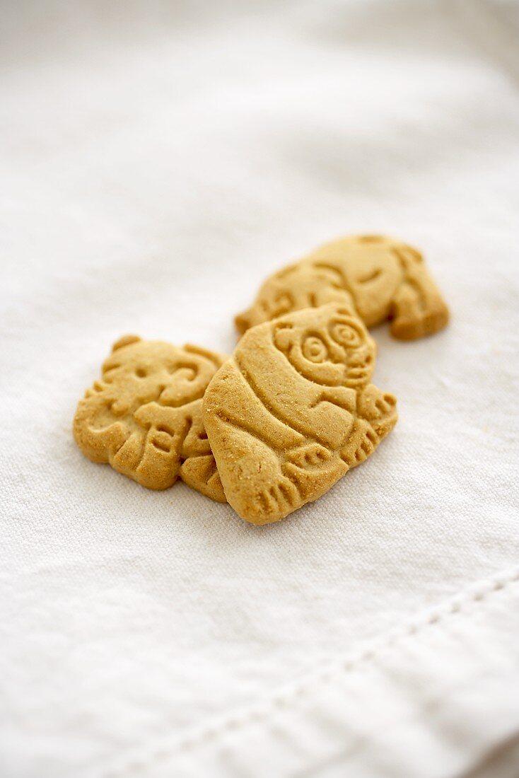 Three Animal Crackers on White Cloth
