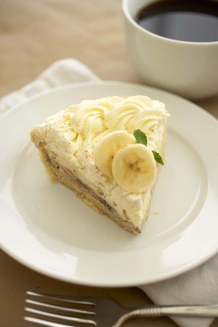 Slice of Banana Cream Pie on a White Plate; With Coffee