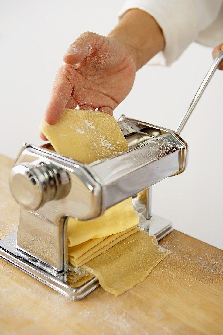 Making Pasta: Passing Sheet of Pasta Through a Pasta Maker