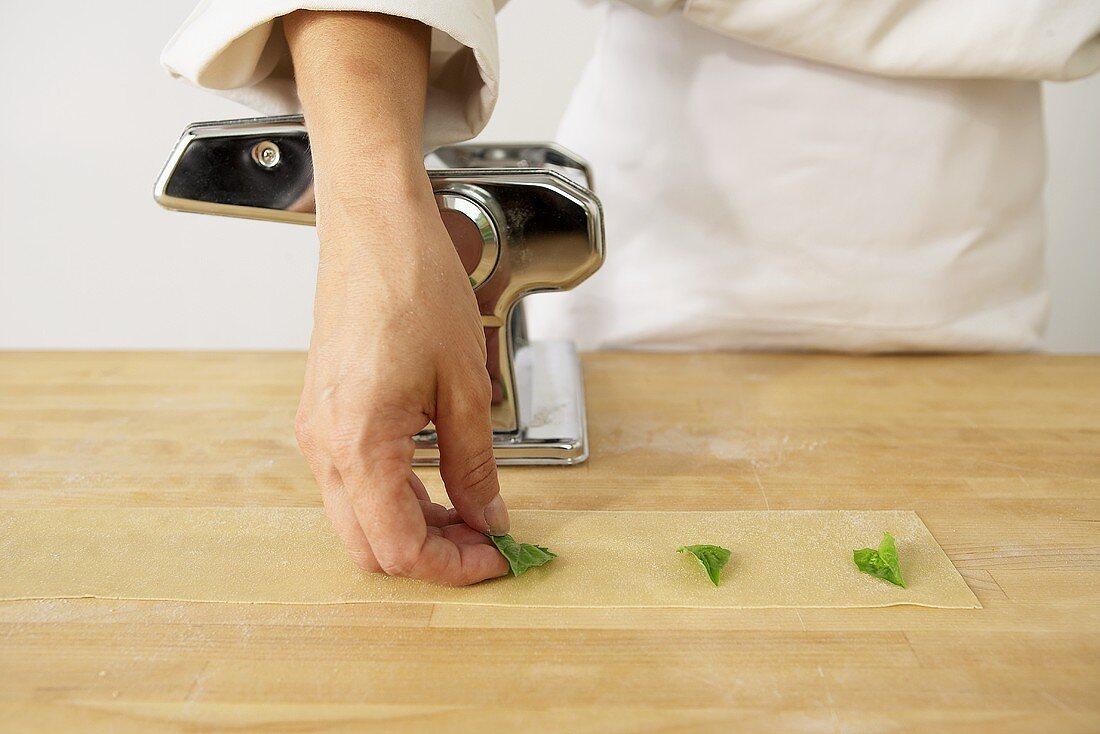 Making Basil Pasta: Laying Basil on Sheet of Pasta