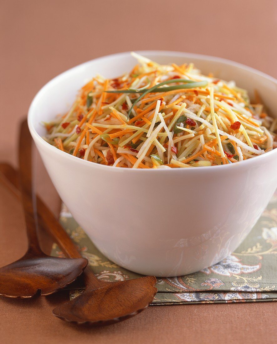 Crunchy Julienned Vegetable Slaw in a White Bowl with Wooden Servers