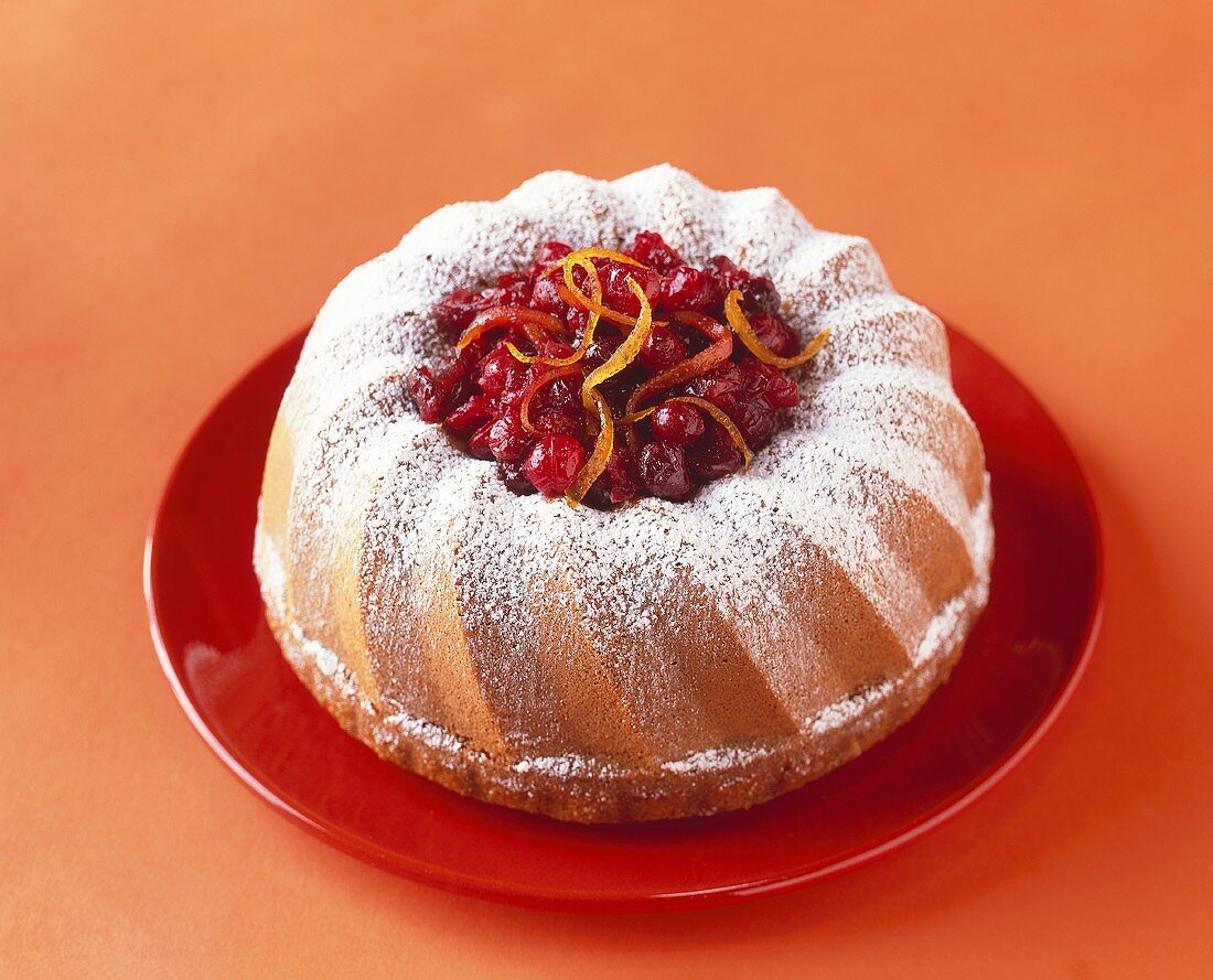 Bundt Cake Filled with Cranberries and Dusted with Powdered Sugar