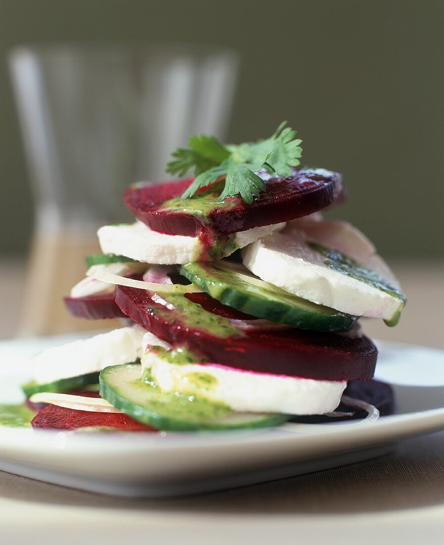 Layered Beet, Mozzarella Cheese and Cucumber Salad with Herb Dressing