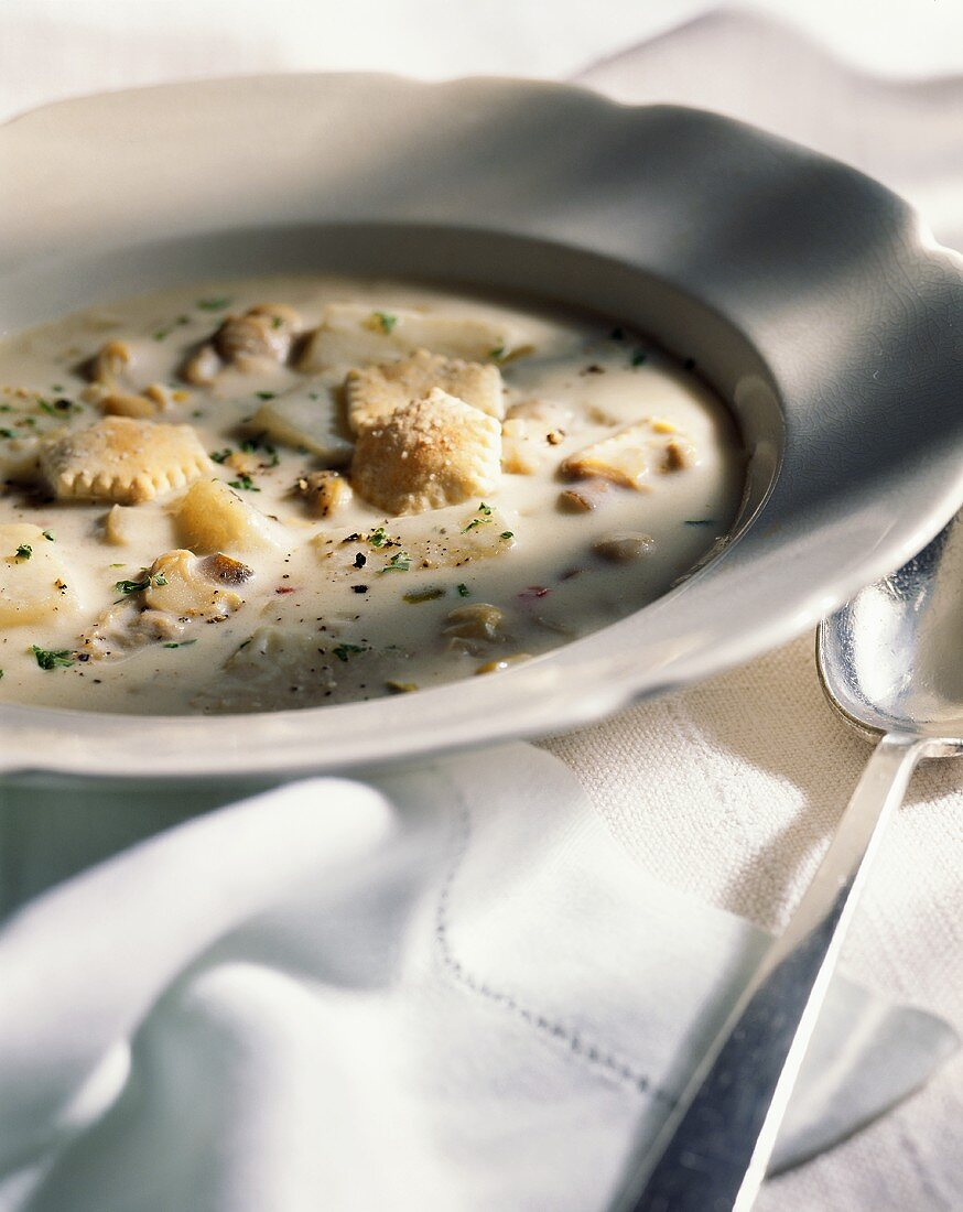 Bowl of Clam Chowder with Oyster Crackers; Spoon