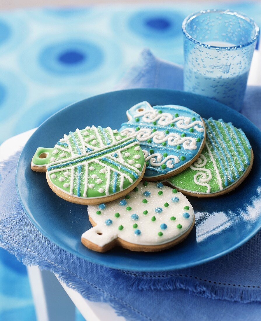 Festive Blue, Green and White Decorated Christmas Bulb Cookies; Glass of Milk