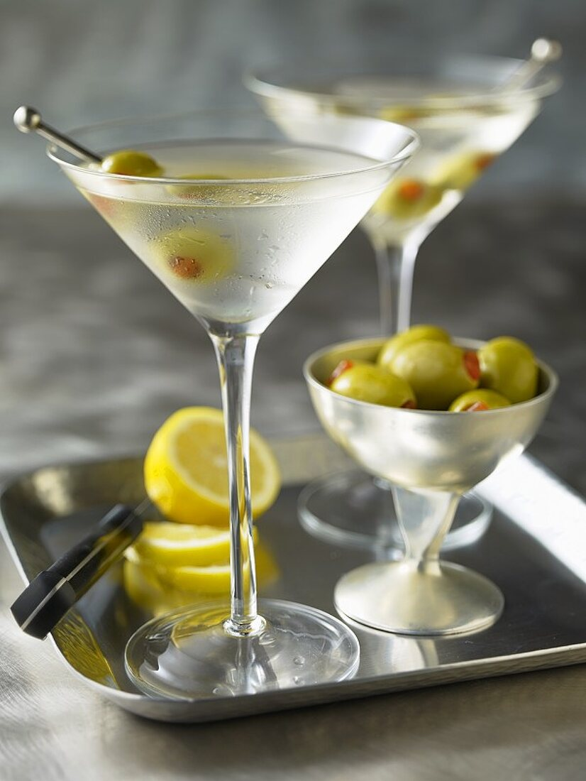 Two Martinis with olives on a tray