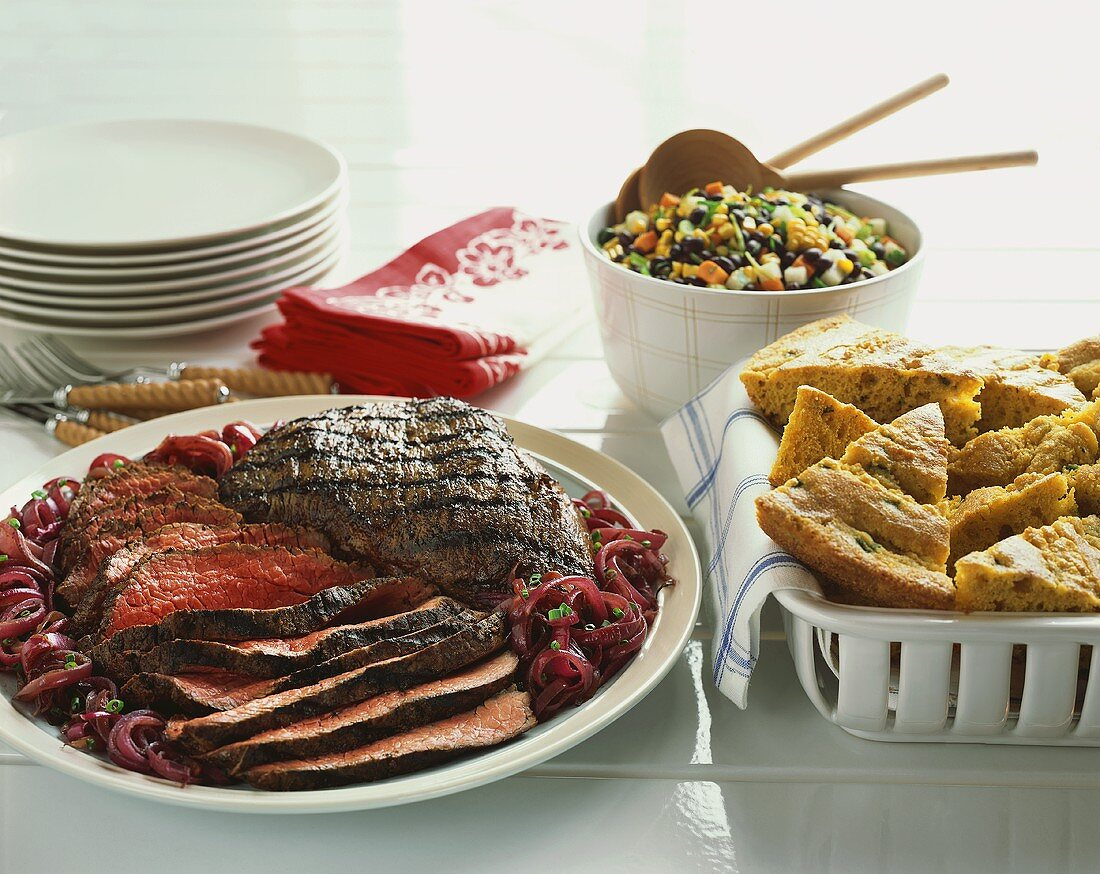 Grilled, Sliced Beef with Corn Bread and Bean Salad