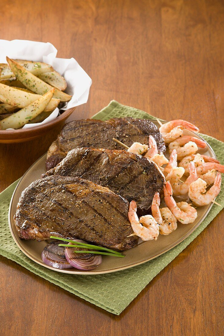 Surf and Turf; Grilled Angus Steaks with Shrimp on a Platter