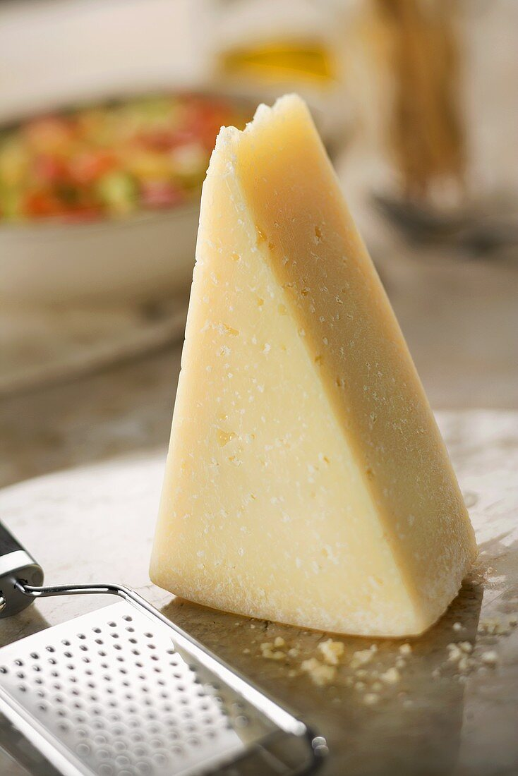 Wedge of Parmesan Cheese with Grater