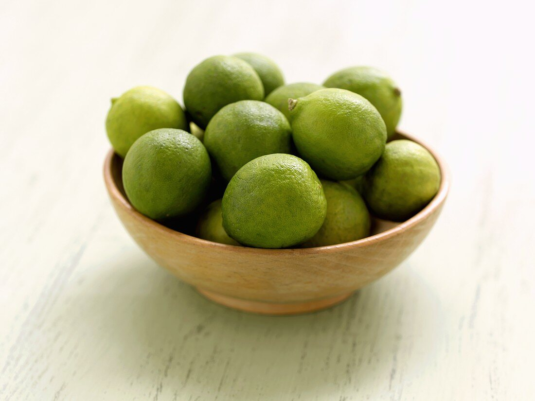 Key Limes in a Wooden Bowl