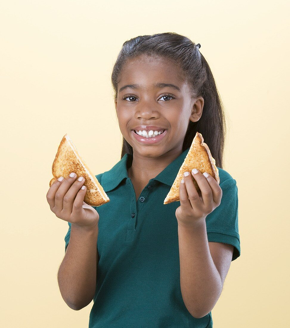 Girl Holding Halved Grilled Cheese Sandwich