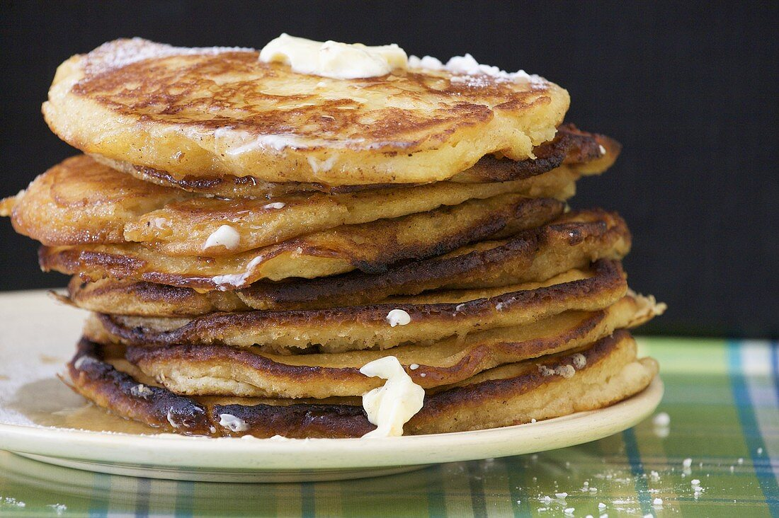 Tall Stack of Pancakes with Butter