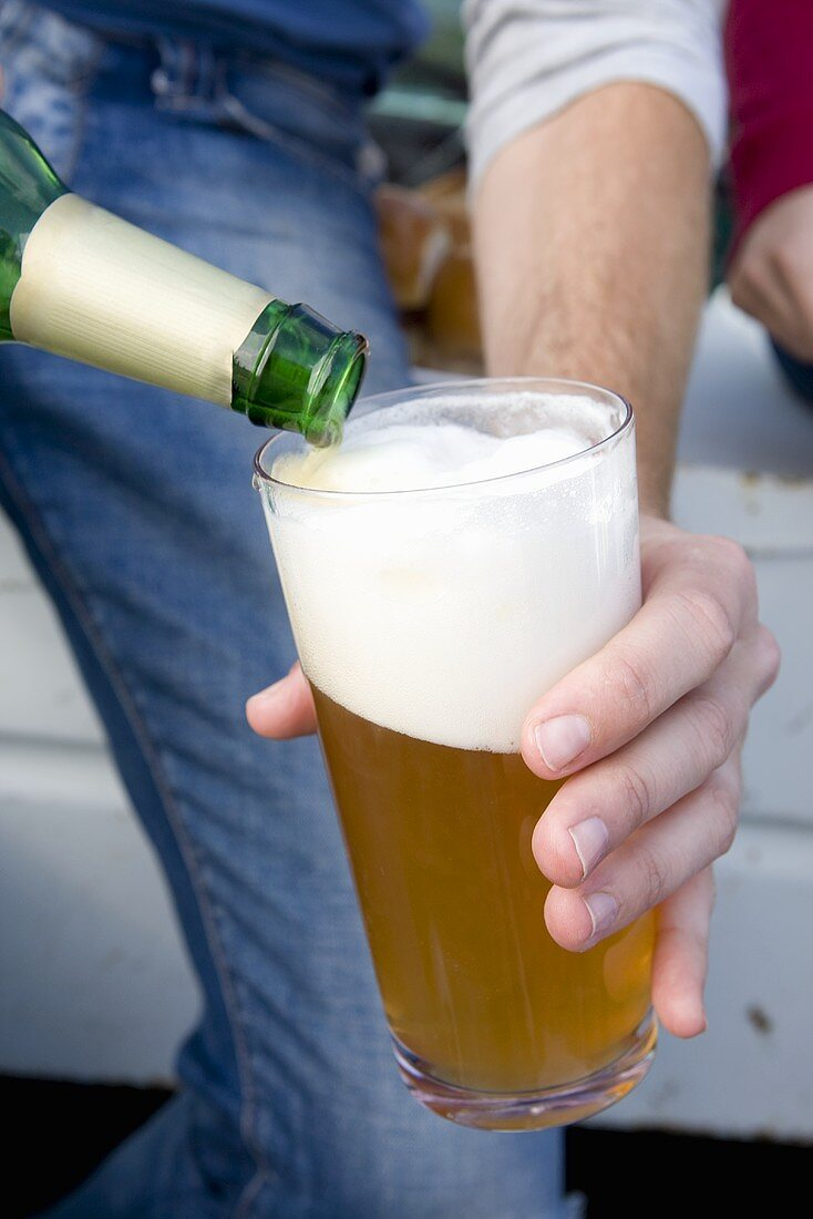 Man Pouring a Beer into a Glass