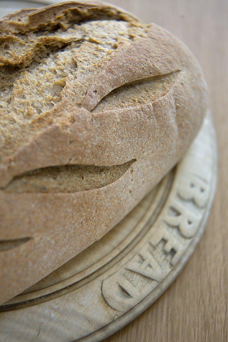 Loaf of Crusty Bread on Board
