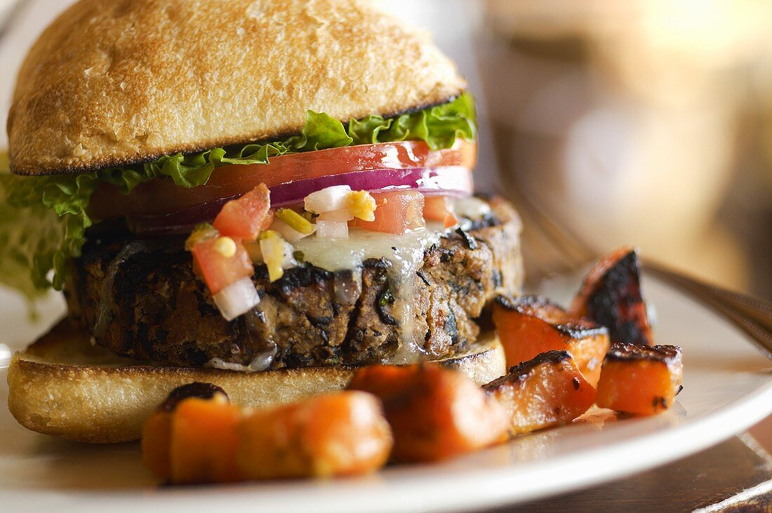 Black Bean Burger with Melted Swiss and on a Bun; Roasted Sweet Potato