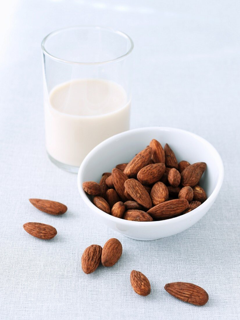 Whole Almonds and a Glass of Almond Milk
