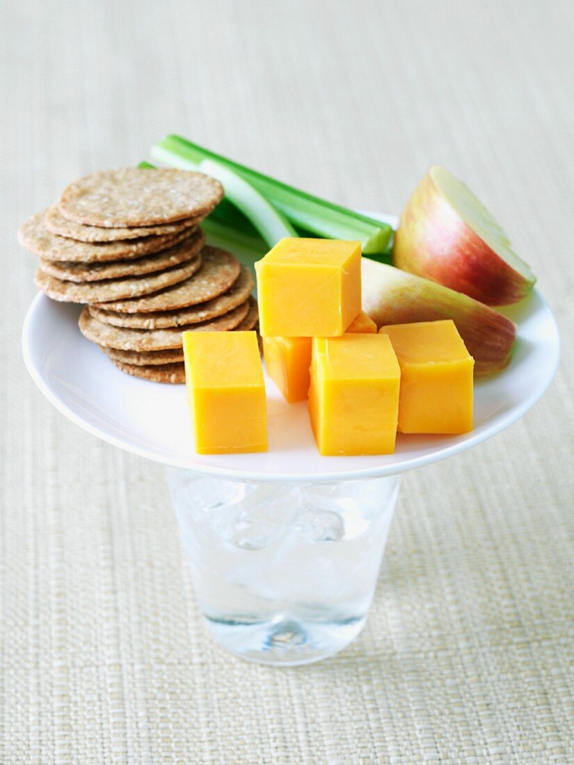 Healthy Snack on a Plate on a Glass of Water