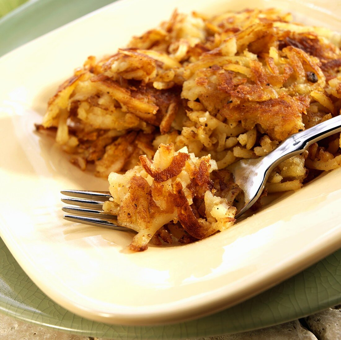 Hash Brown Potatoes on a Plate with Fork