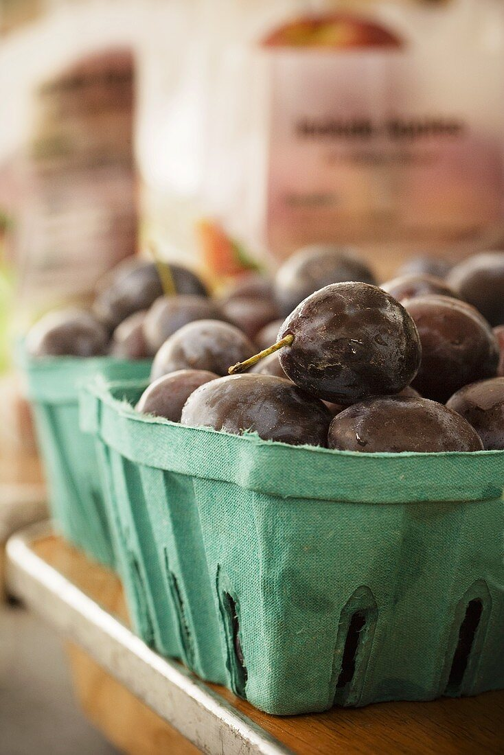 Fresh Plums in Containers at Market
