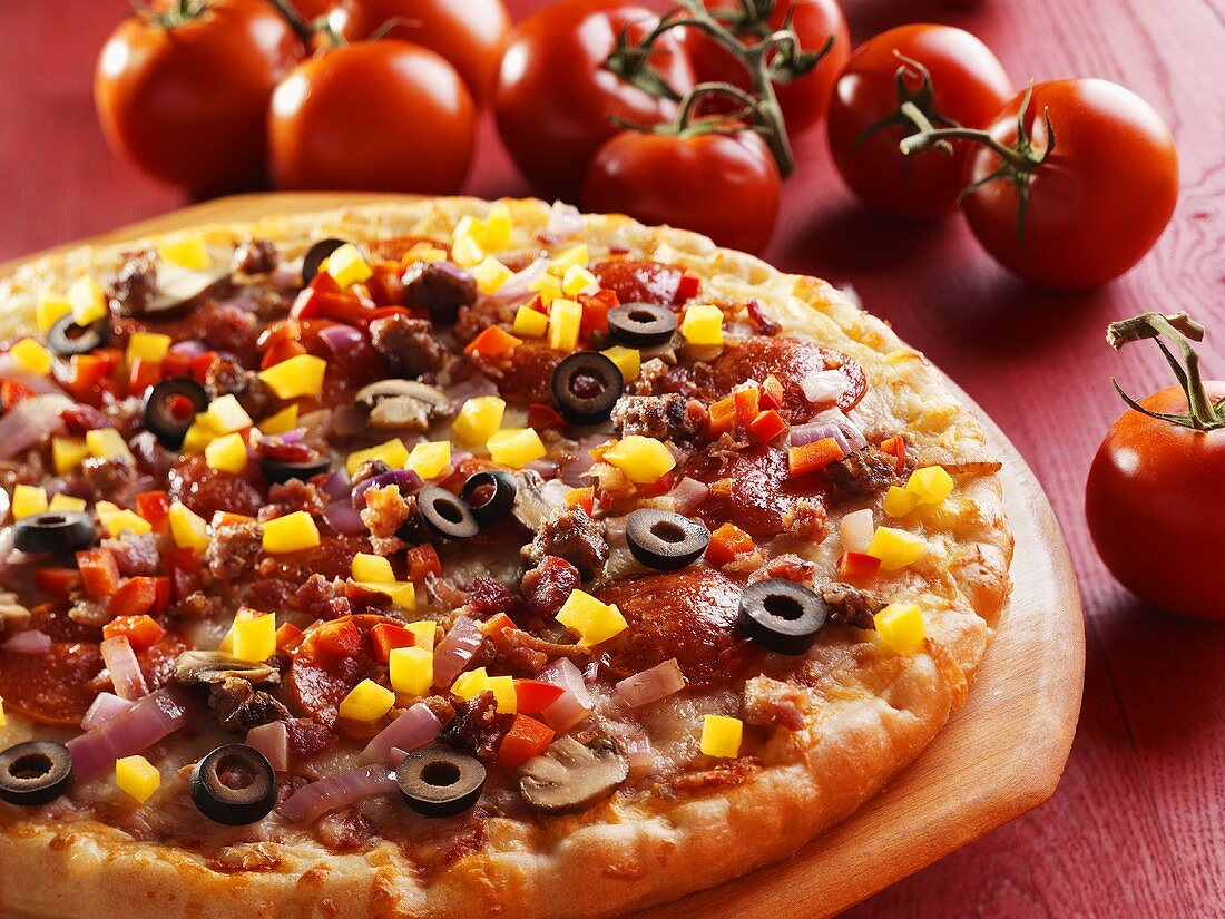 Whole Pizza Topped with Pepperoni, Mushroom, Onion, Black Olives and Diced Peppers