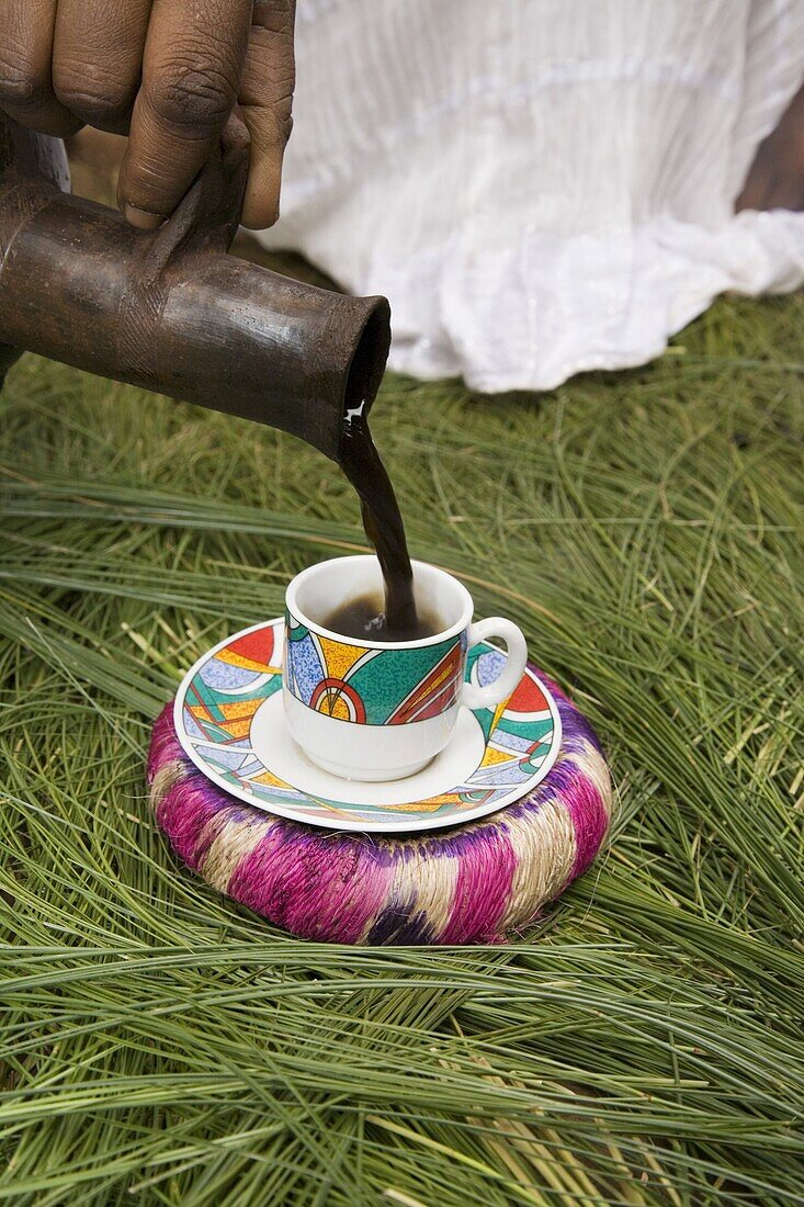 Pouring coffee during a coffee ceremony, Ethiopia, Africa