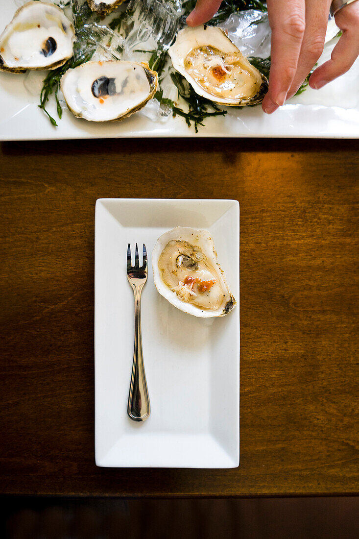 Fresh shucked oysters with pickled shallots and horseradish