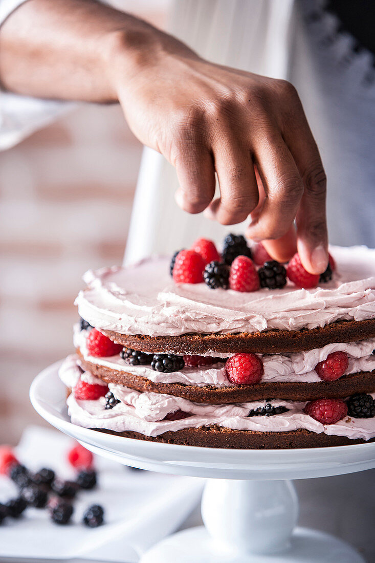 Chocolate cake with berries and cream filling