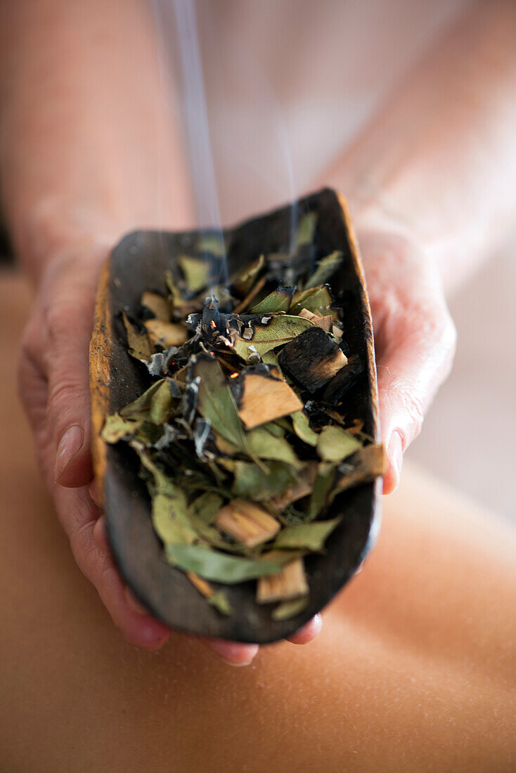 The burning of healing herbs is part of the massage therapy at the Pretty Beach House