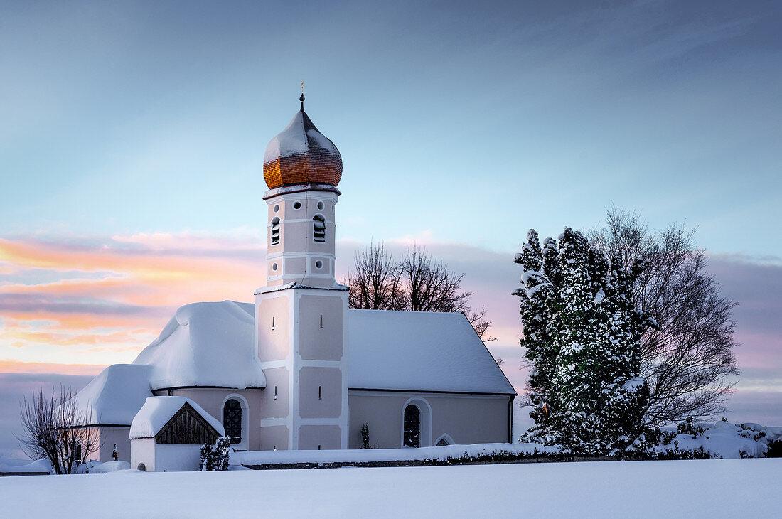 Church on the Ilkahöhe in the snow at sunrise, Tutzing, Bavaria, Germany