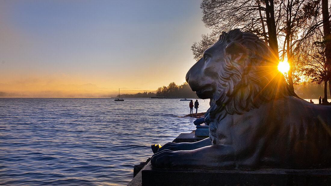 Tutzinger lion overlooking Lake Starnberg,, Tuting, Bavaria, Germany