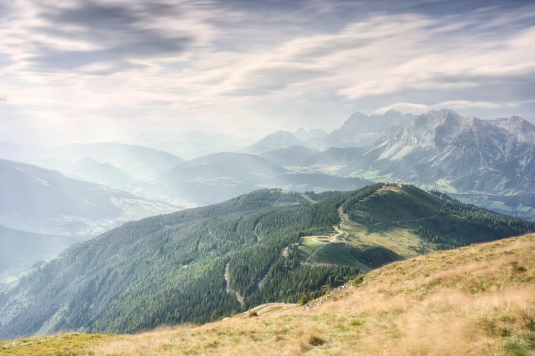 View from Krahbergzinken over the summery Planai down to Schladmin and towards the Dachstein massif, Styria, Austria.