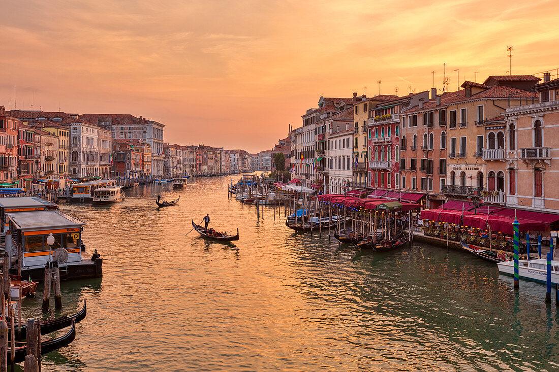 Grand Canal with gondola at sunset from Rialto Bridge in Venice, Veneto, Italy