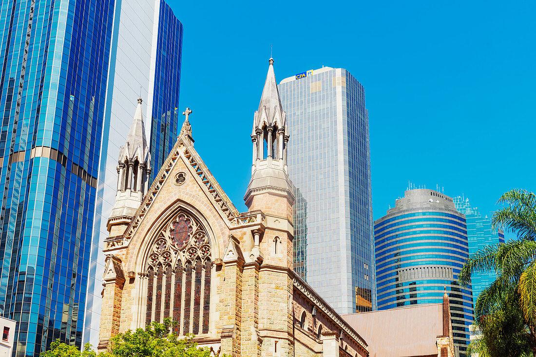 St Stephen's Cathedral dwarfed by glass skyscrapers, Brisbane, Queensland, Australia,