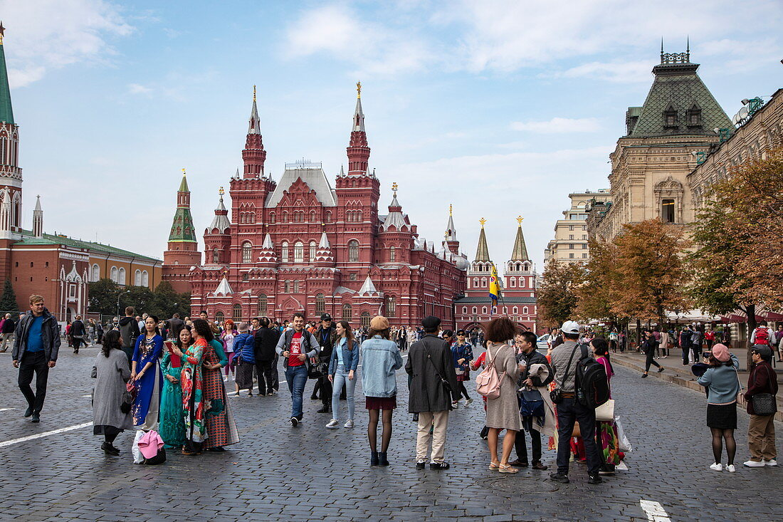 People in Red Square with the State Historical Museum behind it, Moscow, Russia, Europe