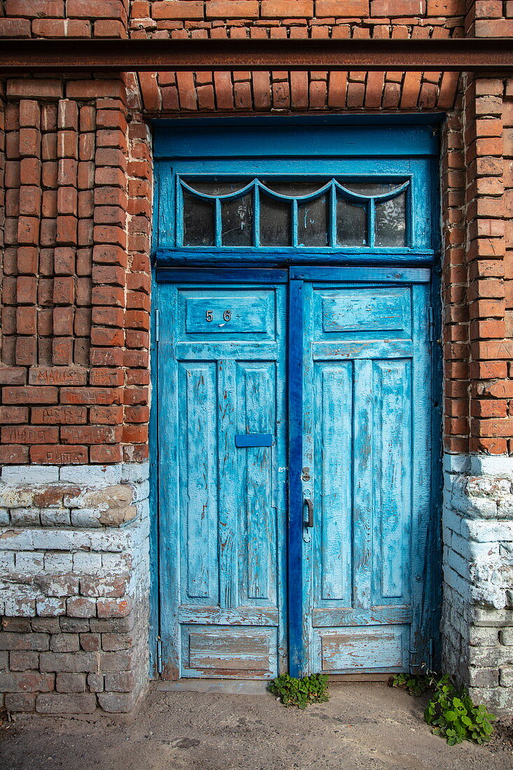 Blue door on red brick house wall, Ulyanovsk, Ulyanovsk District, Russia, Europe