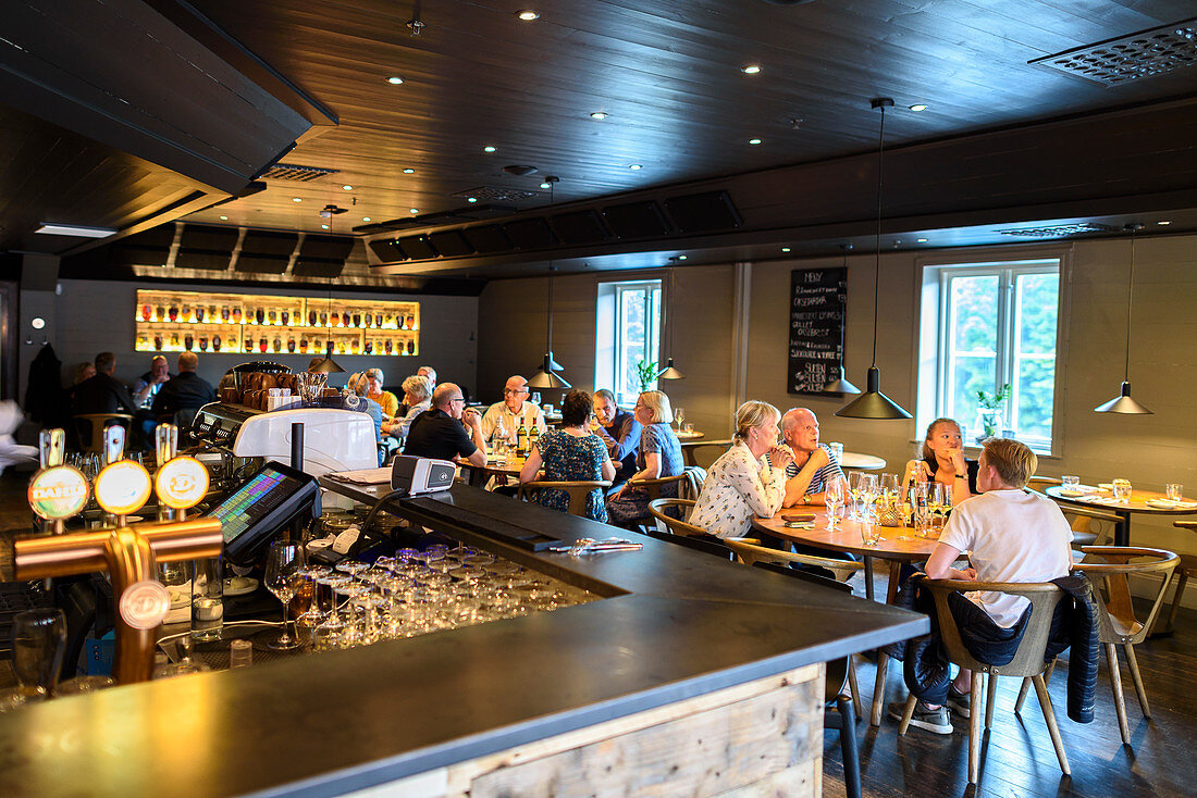 Pub restaurant Den Gode Nabo at the old warehouses on the Nidelva River, Trondheim, Norway