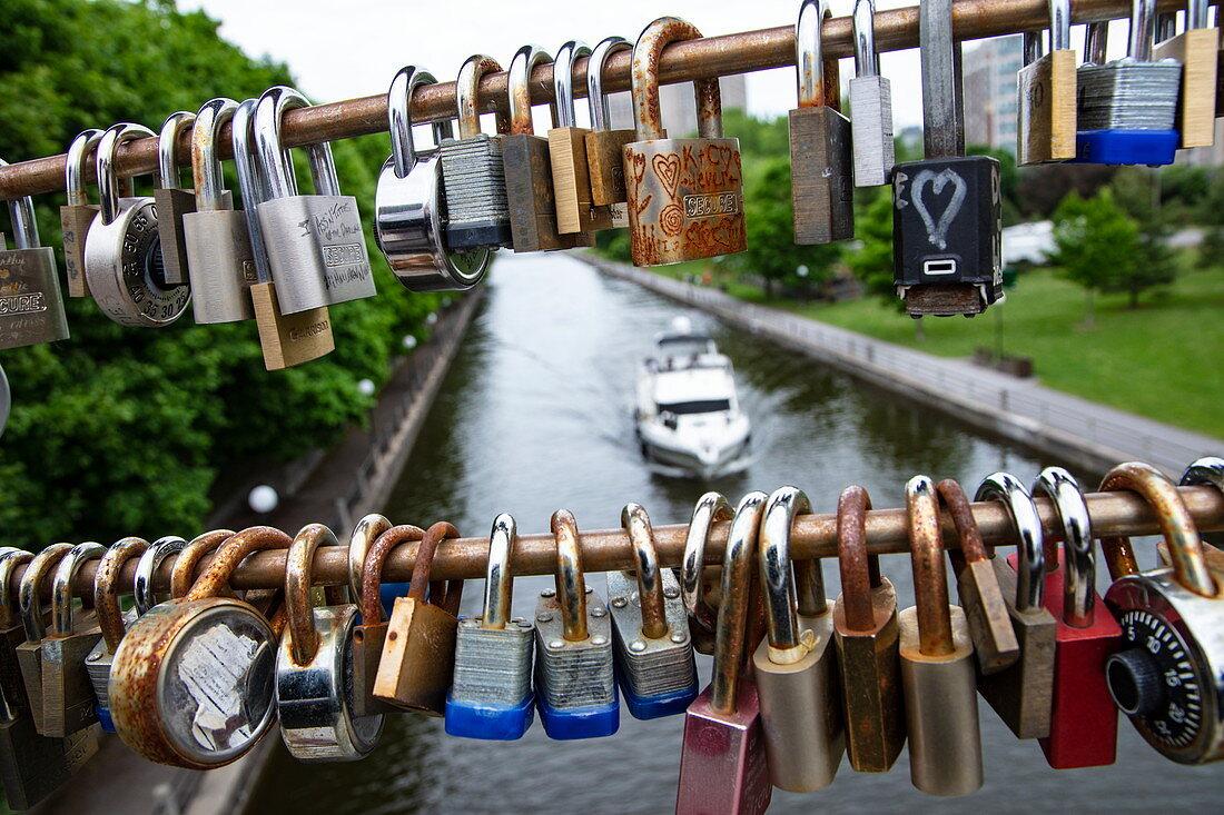 Love locks hang on bridge over the Rideau Canal, Ottawa, Ontario, Canada, North America