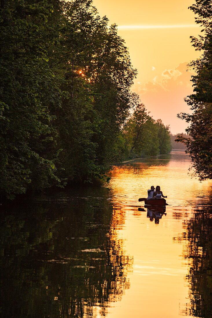 Couple paddling canoe near Beveridge Locks locks on the Tay River at sunset, near Lower Rideau Lake, Ontario, Canada, North America