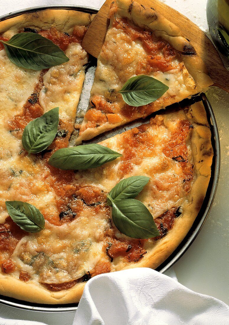 Removing Slice from Pizza Margherita