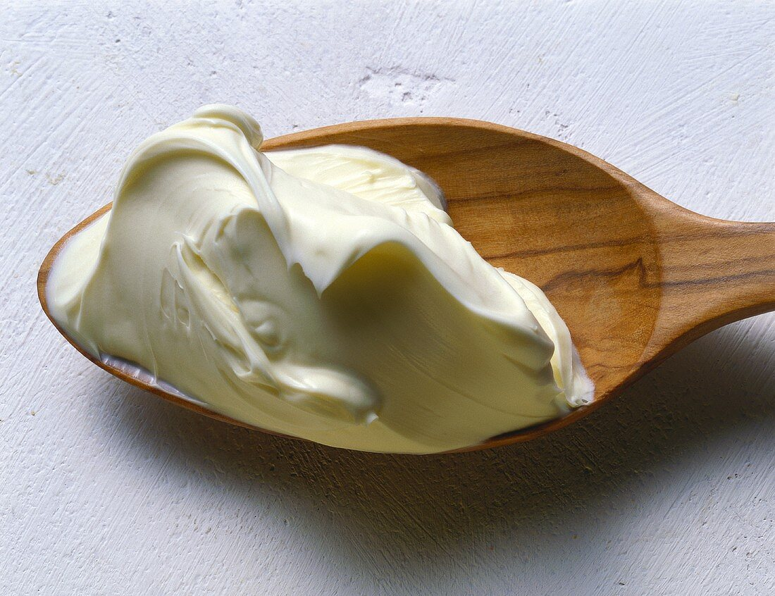 Dollop of Mascarpone Cheese on a Wooden Spoon