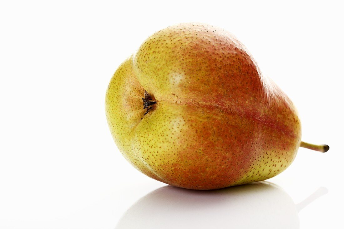 A Forelle pear lying on its side