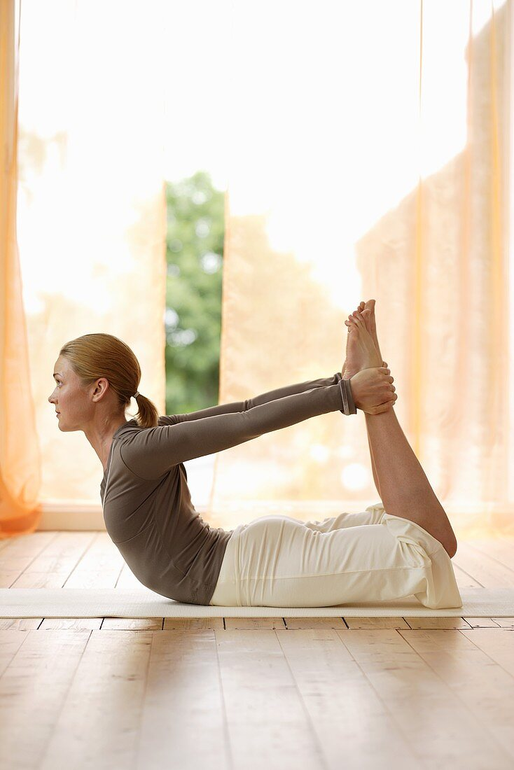 Yoga posture: Dhanurasana (Bow Pose)