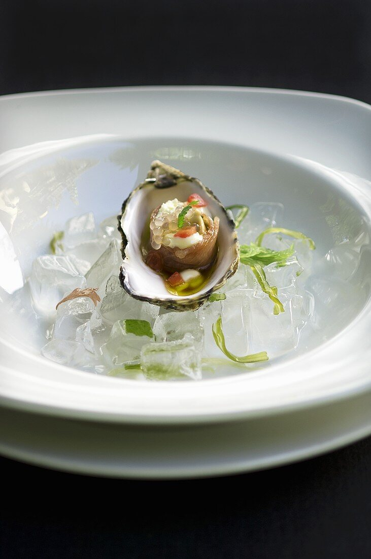 Oyster and salmon sushi in an oyster shell