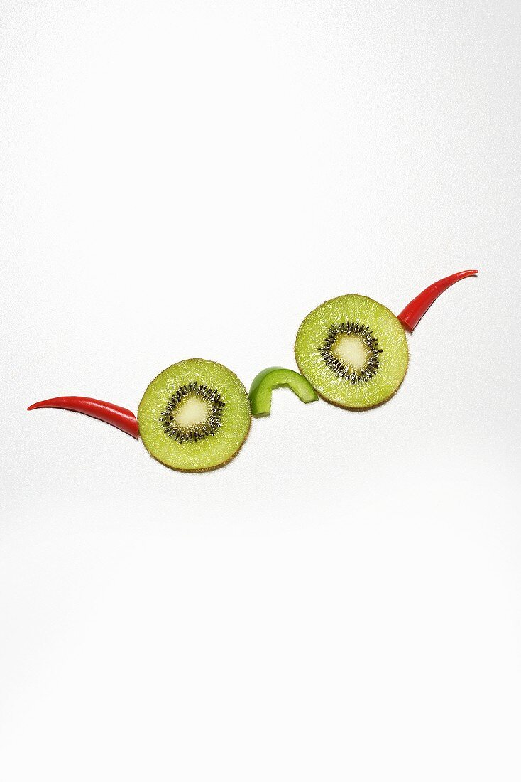 Spectacles made from kiwi fruit slices and chillies